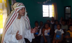 Abraham dresses as a leper to dramatize a Bible story.