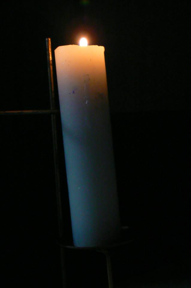 Good Friday: The single lit candle represents Jesus